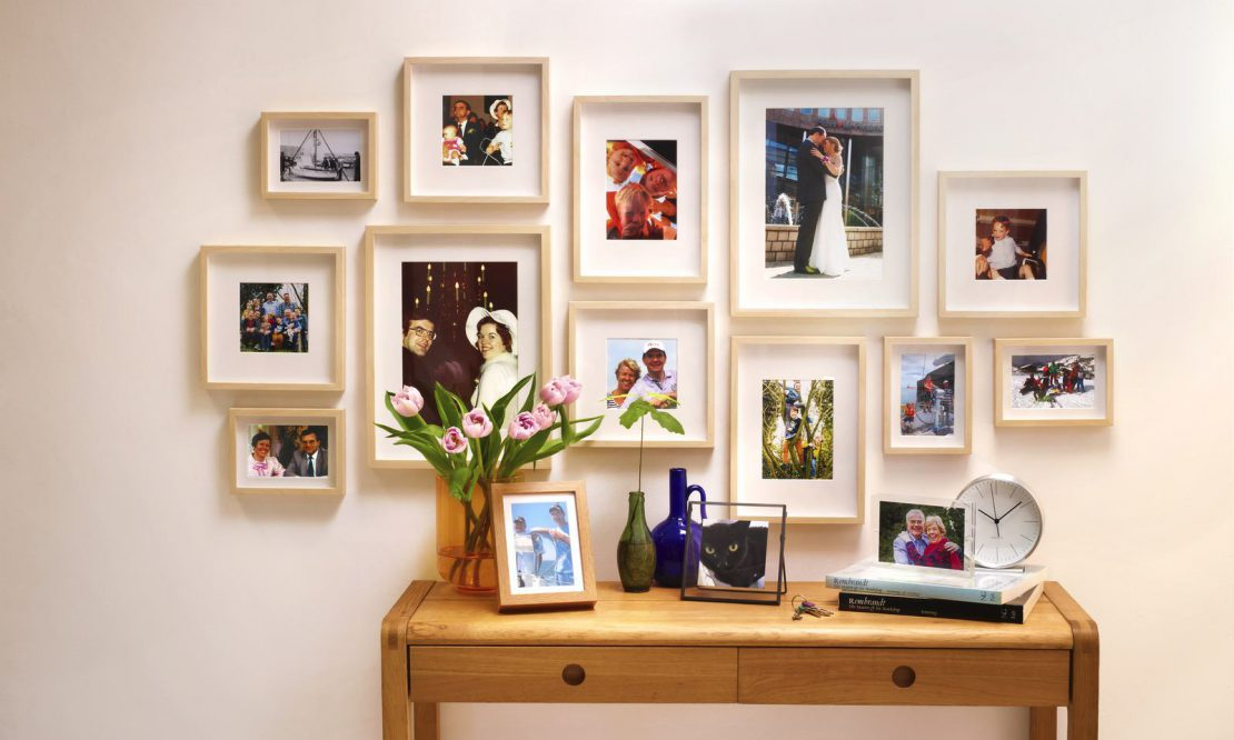 A display of family photographs in frames