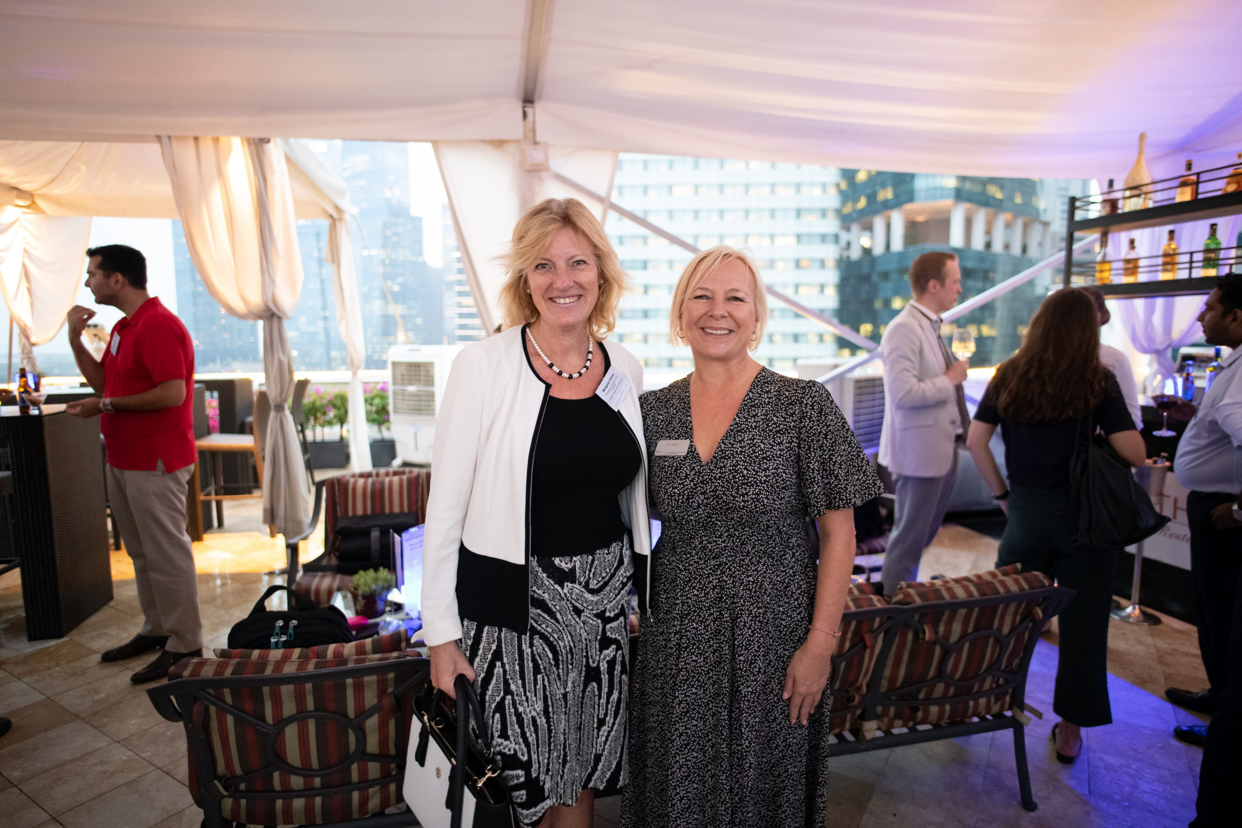 Margriet and Sue standing together at an event
